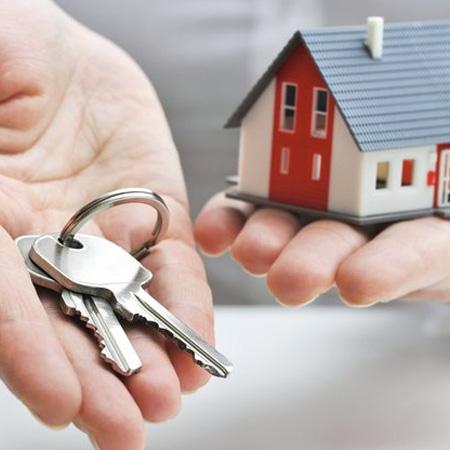 house keys and miniature home model